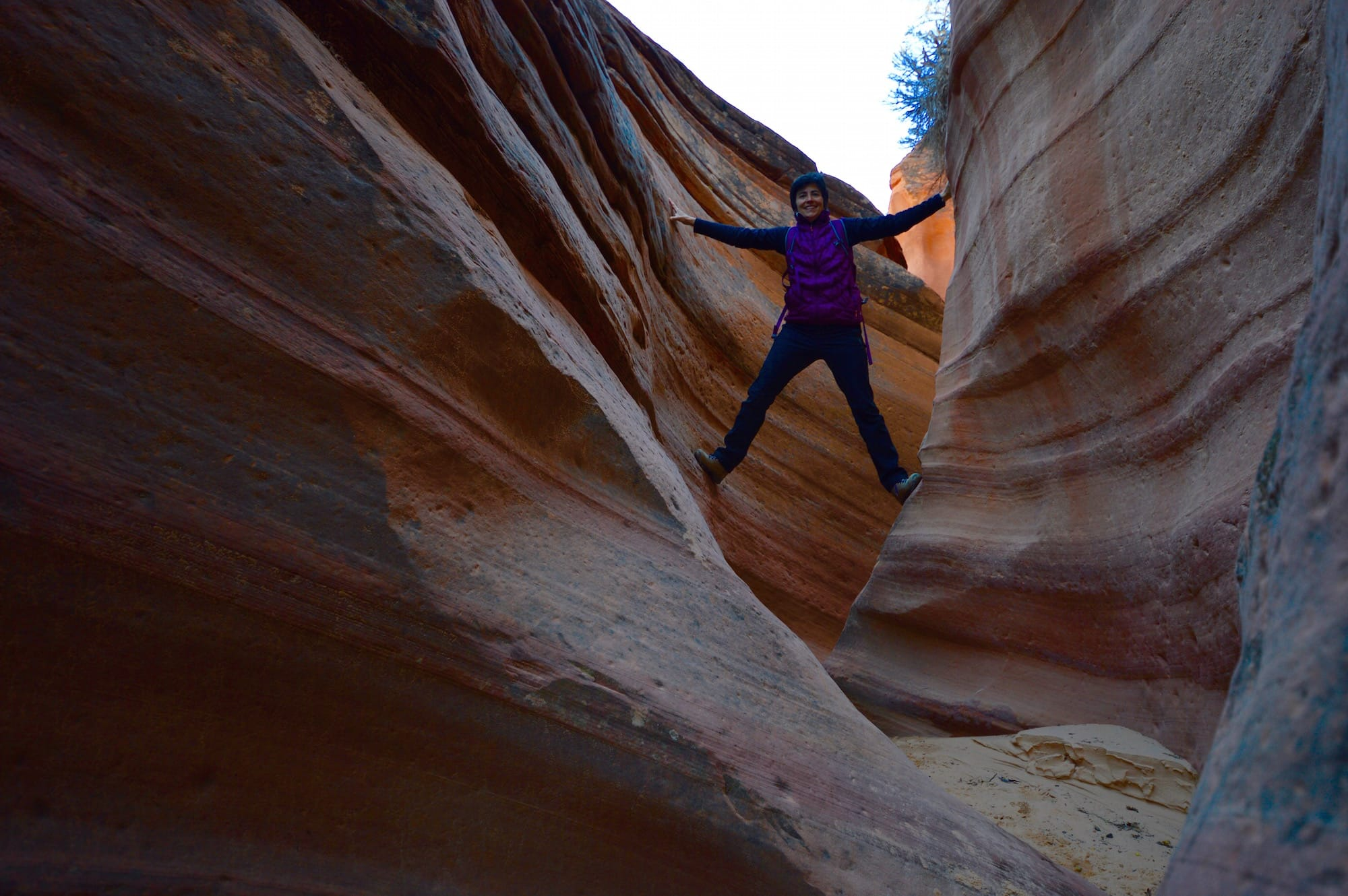Woman climbs in slot canyon