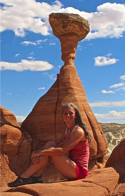 Woman poses in front of Todastool